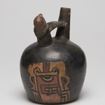 Double Spout Bridge Vessel with Incised Chavin imagery