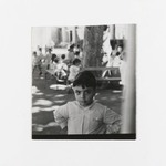 [Untitled] (Young Boy, other Children and Benches in Background)