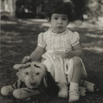 [Untitled] (Child Sitting on Stuffed Tiger)