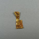 Sheet Amulet with Relief Representations of Goddess Neith Squatting on Hieroglyph of Her Name