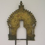 Small Perforated Arched Screen for an Image of Brass