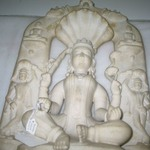 Seated Divinity Surrounded by Tirthankaras