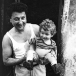 Father Holding Boy with No Underwear, Italy
