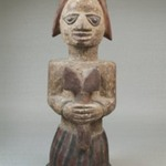 Figure of a Devotee of Shango Holding an Oshe Shango