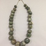 Circular Stone Beads (26) now Strung on Cotton Like a Necklace
