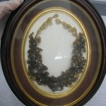 Wreath Enclosed in Oval Frame