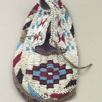 Moccasin with red, white, blue and black geometric beadwork