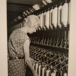 [Untitled] (Elderly Woman at Bank of Thread Cylinders)