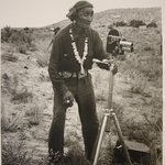 Navajo Indian looking at Camera on Tripod