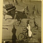 [Untitled]  (Mannequin Body with Shadow against Painting of Piano and Men on Bicycles)