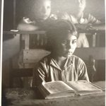[Untitled](Young Girl Seated at Desk in School)