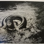 [Untitled] (Juanita Floating in Inner Tube)