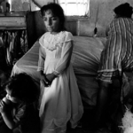 Girl in Confirmation Dress, Rural Poverty
