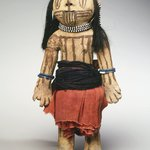 Brown Pottery Doll with Painted Line Designs