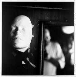 Bruce Cratsley (American, 1944-1998). <em>Glass Shop Mask</em>, 1987. Gelatin silver photograph, image: 9 x 9 in. (22.9 x 22.9 cm). Brooklyn Museum, Alfred T. White Fund, 1991.23.1. © artist or artist's estate (Photo: Brooklyn Museum, 1991.23.1_bw.jpg)