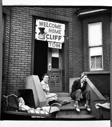 George Gilbert (American, born 1922). <em>Welcome Home: Spring 1946, Red Hook District, Brooklyn, N.Y.</em>, March,1946. Gelatin silver photograph, image: 8 x 8 in. (20.3 x 20.3 cm). Brooklyn Museum, Gift of the artist, 1993.131.1. © artist or artist's estate (Photo: Brooklyn Museum, 1993.131.1_bw.jpg)