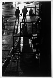 Orville Robertson (American, born Jamaica, 1957). <em>Running Lovers, White Street and Avenue of the Americas, Manhatten</em>, 1986, printed 1994. Gelatin silver photograph, sheet: 13 15/16 × 10 7/8 in. (35.4 × 27.6 cm). Brooklyn Museum, Purchased with funds given by the Horace W. Goldsmith Foundation, Harry Kahn, and Mrs. Carl L. Selden, 1994.130. © artist or artist's estate (Photo: Brooklyn Museum, 1994.130_bw.jpg)