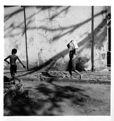 Bastienne Schmidt. <em>Boys working in Cemetery, from the series Day of the Dead (Vivir La Muerte)</em>, 1994. Gelatin silver photograph, sheet: 20 x 16 in. Brooklyn Museum, Purchased with funds given by the Horace W. Goldsmith Foundation, Ardian Gill and the Coler Foundation, 1995.163.3. © artist or artist's estate (Photo: Brooklyn Museum, 1995.163.3_bw.jpg)