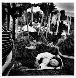 Bastienne Schmidt. <em>Girl Sleeping at the Cemetery on the Day of the Dead, from the series Day of the Dead (Vivir La Muerte)</em>, 1993. Gelatin silver photograph, sheet: 20 x 16 in. Brooklyn Museum, Gift of the artist, 1995.168.4. © artist or artist's estate (Photo: Brooklyn Museum, 1995.168.4_bw.jpg)