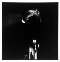 Bruce Cratsley (American, 1944-1998). <em>Billy Smelling Amaryllis</em>, 1995. Selenium-toned gelatin silver photograph, image: 9 1/2 x 9 1/4 in. (24.1 x 23.5 cm). Brooklyn Museum, Gift of Jonathan L. Fagin, 1995.207.10. © artist or artist's estate (Photo: Brooklyn Museum, 1995.207.10_bw.jpg)