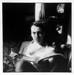 Bruce Cratsley (American, 1944-1998). <em>Billy Reading</em>, 1994. Selenium-toned gelatin silver photograph, image: 9 1/2 x 9 1/4 in. (24.1 x 23.5 cm). Brooklyn Museum, Gift of Jonathan L. Fagin, 1995.207.6. © artist or artist's estate (Photo: Brooklyn Museum, 1995.207.6_bw.jpg)