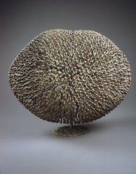 Harry Bertoia (American, born Italy, 1915-1978). <em>Bush</em>, ca. 1975. Bronze, dark red and green patina, 15 × 19 × 14 in., 29.5 lb. (38.1 × 48.3 × 35.6 cm, 13.38kg). Brooklyn Museum, Bequest of Mrs. Carl L. Selden, 1996.150.7. © artist or artist's estate (Photo: Brooklyn Museum, 1996.150.7_transp5592.jpg)