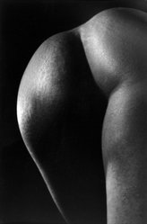 Ruth Bernhard (American, born Germany, 1905-2006). <em>Untitled (Lower Back of Nude Woman)</em>, 1963. Gelatin silver photograph, image/sheet: 6 7/16 x 9 1/2 in. (16.4 x 24.1 cm). Brooklyn Museum, Gift of Eileen and Michael Cohen, 1996.237.1. © artist or artist's estate (Photo: Brooklyn Museum, 1996.237.1_bw.jpg)