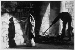 Orville Robertson (American, born Jamaica, 1957). <em>Homeless Man Stoking His Fire, Riverside Park, NYC</em>, 1985, printed 1998. Gelatin silver photograph, sheet: 19 3/4 x 16 in. (50.2 x 40.6 cm). Brooklyn Museum, Gift of Wallace B. Putnam from the Estate of Consuelo Kanaga, by exchange, 1999.123. © artist or artist's estate (Photo: Brooklyn Museum, 1999.123_bw.jpg)