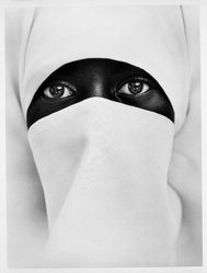 Chester Higgins Jr. (American, born 1946). <em>A Young Muslim Woman in Brooklyn</em>, 1990, printed 1998. Toned gelatin silver photograph, sheet: 24 x 20 in. (61 x 50.8 cm). Brooklyn Museum, Purchased with funds given by Karen B. Cohen in memory of Gilbert Millstein, 1999.86. © artist or artist's estate (Photo: Brooklyn Museum, 1999.86_bw.jpg)