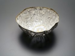 So, Jin-Sook (Korean, born 1950). <em>Floral Form</em>, 2000. Steel mesh and thread with painted and electroplated gold and silver decoration, 3 x 4 3/8 in.  (7.6 x 11.1 cm). Brooklyn Museum, Anonymous gift in honor of Amy G. Poster, 2001.49.3. © artist or artist's estate (Photo: Brooklyn Museum, 2001.49.3_transp5017.jpg)