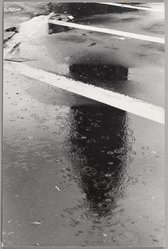 Rudy Burckhardt (American, 1914-1999). <em>Flat Iron Building, New York</em>, 1973. Gelatin silver photograph on board, 13 3/8 x 9 in. (34 x 22.9 cm). Brooklyn Museum, Gift of the Alex Katz Foundation, 2008.45.9. © artist or artist's estate (Photo: Brooklyn Museum, 2008.45.9_PS9.jpg)