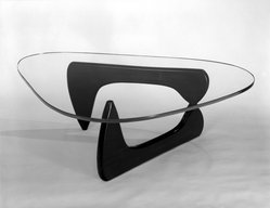 Isamu Noguchi (American, 1904-1988). <em>Lounge Table</em>, Designed 1944; Manufactured 1945. Glass, walnut, Overall: 15 3/4 x 50 x 36 in.  (40.0 x 127.0 x 91.4 cm);. Brooklyn Museum, Gift of Mr. and Mrs. H. Lawrence Herring, 76.96a-c. © artist or artist's estate (Photo: Brooklyn Museum, 76.96_bw.jpg)
