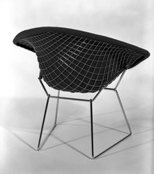 "Harry Bertoia (American, born Italy, 1915-1978). <em>""Diamond"" Armchair</em>, Designed 1952; Manufactured ca. 1970. Steel, plastic, rubber, cotton, Overall: 30 x 34 x 28 in.  (76.2 x 86.4 x 71.1 cm.). Brooklyn Museum, Gift of Knoll International, Inc., 78.128.8. © artist or artist's estate (Photo: Brooklyn Museum, 78.128.8_back_bw_IMLS.jpg)"