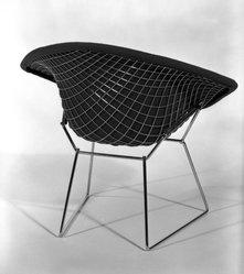 "Harry Bertoia (American, born Italy, 1915-1978). <em>""Diamond"" Armchair</em>, Designed 1952; Manufactured ca. 1970. Steel, plastic, rubber, cotton, Overall: 30 x 34 x 28 in.  (76.2 x 86.4 x 71.1 cm.). Brooklyn Museum, Gift of Knoll International, Inc., 78.128.8. © artist or artist's estate (Photo: Brooklyn Museum, 78.128.8_back_bw_IMLS.jpg)"