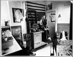 Sam Falk (American, 1901-1991). <em>Janis Joplin in Her Apartment on Noe Street in the Upper Mission District of San Francisco</em>, February 1969. Photograph, image: 10 3/4 x 13 3/4 in. (27.3 x 34.9 cm). Brooklyn Museum, Gift of the artist, 81.144. © artist or artist's estate (Photo: Brooklyn Museum, 81.144_bw.jpg)