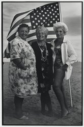 Victor Friedman (American, born 1930). <em>Three Women and Flag, Coney Island</em>, 1972. Gelatin silver photograph, image: 12 3/4 x 8 5/16 in. (32.4 x 21.1 cm). Brooklyn Museum, Gift of the artist, 83.76.6. © artist or artist's estate (Photo: Brooklyn Museum, 83.76.6_PS2.jpg)
