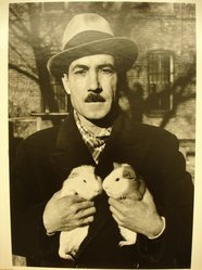 Sidney Kerner (American, 1920-2013). <em>Coney Island, Man with Guinea Pigs</em>, 1937; printed later. Gelatin silver photograph, sheet: 14 x 10 7/8 in. Brooklyn Museum, Gift of the artist, 1995.128.3. © artist or artist's estate (Photo: Brooklyn Museum, CUR.1995.128.3.jpg)