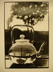 Linda McCartney (American, 1941-1998). <em>Through a Glass Teapot</em>, 1996. Silver bromide print on mold-made paper, Image: 11 3/4 x 8 in.  (29.8 x 20.3 cm). Brooklyn Museum, Purchased with funds given by the Horace W. Goldsmith Foundation, Karen B. Cohen, and Ardian Gill, 1998.114.2. © artist or artist's estate (Photo: Brooklyn Museum, CUR.1998.114.2.jpg)