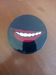 Sanford Biggers (American, born 1970). <em>Cheshire Smile</em>, 2008. Plastic, 2 x 4 in. (5.1 x 10.2 cm). Brooklyn Museum, Gift of Ellen Holtzman, 2015.75.12. © artist or artist's estate (Photo: Brooklyn Museum, CUR.2015.75.12.jpg)