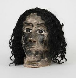 """James """"Son Ford"""" Thomas (American, 1926-1993). <em>Untitled</em>, 1987. unfired clay, fiber (artificial hair), metal (iron alloy), glass, overall: 8 × 9 × 9 1/4 in., 9 lb. (20.3 × 22.9 × 23.5 cm, 4.08kg). Brooklyn Museum, Gift of the Souls Grown Deep Foundation from the William S. Arnett Collection, 2018, 2018.28.4. © artist or artist's estate (Photo: , CUR.2018.28.4.jpg)"""