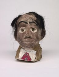 """James """"Son Ford"""" Thomas (American, 1926-1993). <em>Untitled</em>, 1987. unfired clay, paint, fiber (artificial hair), glass (marbles), overall: 9 × 7 1/2 × 7 in., 13 lb. (22.9 × 19.1 × 17.8 cm, 5.9kg). Brooklyn Museum, Gift of the Souls Grown Deep Foundation from the William S. Arnett Collection, 2018, 2018.28.5. © artist or artist's estate (Photo: , CUR.2018.28.5.jpg)"""