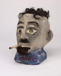 """James """"Son Ford"""" Thomas (American, 1926-1993). <em>Untitled</em>, 1987. Unfired clay, fiber (artificial hair), paper, tobacco (cigarette), glass (marbles), metal - iron alloy (pin) and white metal? (coin), overall: 8 1/2 × 7 1/4 × 10 3/4 in., 12 lb. (21.6 × 18.4 × 27.3 cm, 5.44kg). Brooklyn Museum, Gift of the Souls Grown Deep Foundation from the William S. Arnett Collection, 2018, 2018.28.6. © artist or artist's estate (Photo: , CUR.2018.28.6.jpg)"""