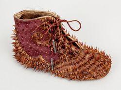 Nancy Youdelman (American, born 1948). <em>Thorn Shoe</em>, 1976. Textile, leather, metal, organic material, 3 × 5 × 2 in. (7.6 × 12.7 × 5.1 cm). Brooklyn Museum, Gift of Gail Levin and John B. Van Sickle, 2018.35. © artist or artist's estate (Photo: , CUR.2018.35.jpg)