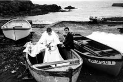 Mary Ellen Mark (American, 1940-2015). <em>Wedding Couple in Boat on Beach, France</em>, 1970; printed ca. 1970. Gelatin silver photograph, Sheet: 11 × 13 15/16 in. (27.9 × 35.4 cm). Brooklyn Museum, Gift of Howard Greenberg, 2019.50.11. © artist or artist's estate (Photo: Image courtesy of the estate of Mary Ellen Mark, CUR.2019.50.11_MaryEllenMarkEstate_photograph.jpg)