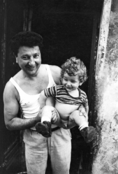 Mary Ellen Mark (American, 1940-2015). <em>Father Holding Boy with No Underwear, Italy</em>, 1965; printed ca. 1965. Gelatin silver photograph, Sheet: 14 × 10 15/16 in. (35.6 × 27.8 cm). Brooklyn Museum, Gift of Howard Greenberg, 2019.50.13. © artist or artist's estate (Photo: Image courtesy of the estate of Mary Ellen Mark, CUR.2019.50.13_MaryEllenMarkEstate_photograph.jpg)