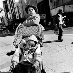 Mary Ellen Mark (American, 1940-2015). <em>Black Children In/on Stroller, Times Square</em>, 1997; printed ca. 1997. Gelatin silver photograph, Sheet: 13 7/8 × 10 7/8 in. (35.2 × 27.6 cm). Brooklyn Museum, Gift of Howard Greenberg, 2019.50.2. © artist or artist's estate (Photo: Image courtesy of the estate of Mary Ellen Mark, CUR.2019.50.2_MaryEllenMarkEstate_photograph.jpg)