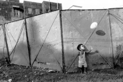 Mary Ellen Mark (American, 1940-2015). <em>Boy with Face Painted Playing with Balloon, Great Royal Circus, Goa, India, Asoc Scout</em>, 1996; printed later. Gelatin silver photograph, Sheet: 15 7/8 × 19 7/8 in. (40.3 × 50.5 cm). Brooklyn Museum, Gift of Howard Greenberg, 2019.50.3. © artist or artist's estate (Photo: Image courtesy of the estate of Mary Ellen Mark, CUR.2019.50.3_MaryEllenMarkEstate_photograph.jpg)