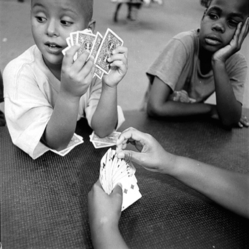 Mary Ellen Mark (American, 1940-2015). <em>Kids Playing Cards, Help Portraits</em>, 1993; printed later. Gelatin silver photograph, Sheet: 19 7/8 × 16 in. (50.5 × 40.6 cm). Brooklyn Museum, Gift of Howard Greenberg, 2019.50.4. © artist or artist's estate (Photo: Image courtesy of the estate of Mary Ellen Mark, CUR.2019.50.4_MaryEllenMarkEstate_photograph.jpg)
