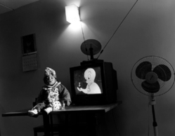Mary Ellen Mark (American, 1940-2015). <em>Little Clown and TV, Help Portraits</em>, 1993; printed later. Gelatin silver photograph, Sheet: 16 × 19 13/16 in. (40.6 × 50.3 cm). Brooklyn Museum, Gift of Howard Greenberg, 2019.50.5. © artist or artist's estate (Photo: Image courtesy of the estate of Mary Ellen Mark, CUR.2019.50.5_MaryEllenMarkEstate_photograph.jpg)