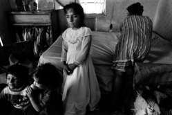 Mary Ellen Mark (American, 1940-2015). <em>Girl in Confirmation Dress, Rural Poverty</em>, 1990; printed later. Gelatin silver photograph, Sheet: 15 7/8 × 19 15/16 in. (40.3 × 50.6 cm). Brooklyn Museum, Gift of Howard Greenberg, 2019.50.6. © artist or artist's estate (Photo: Image courtesy of the estate of Mary Ellen Mark, CUR.2019.50.6_MaryEllenMarkEstate_photograph.jpg)